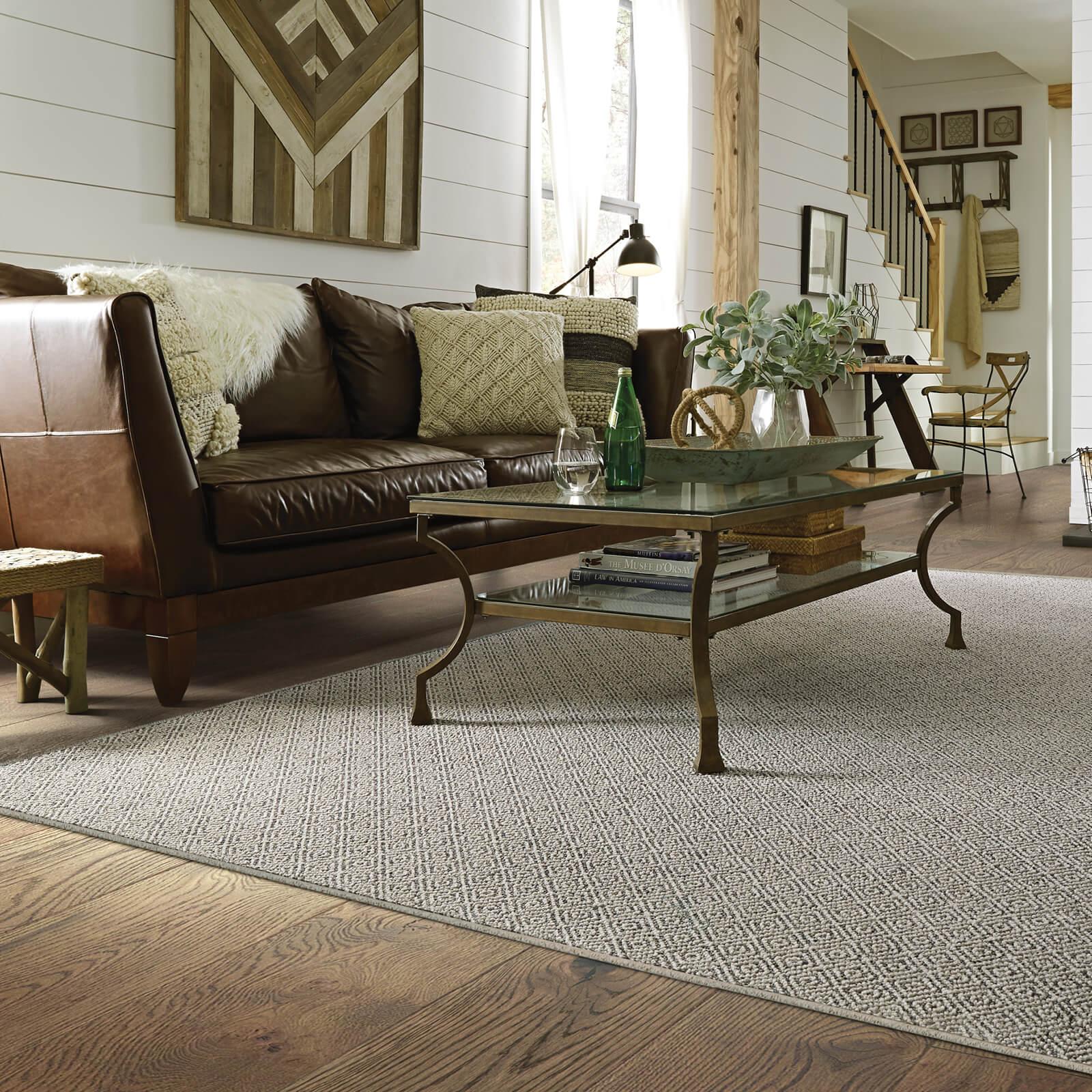 Sofa and coffee table on floor | Kirkland's Flooring